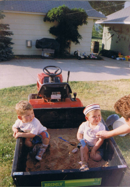 boys in mower trailer