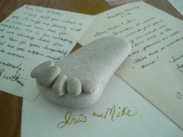 The little rock foot on top of the decoupaged notes from guests, in my office
